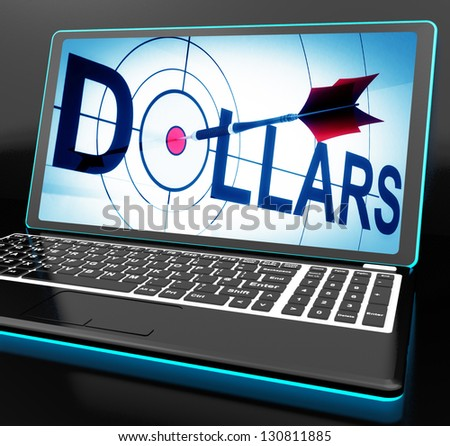 Dollars On Laptop Shows Financial Currencies And Revenues