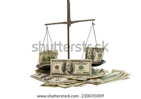 dollars on the scales on a white background