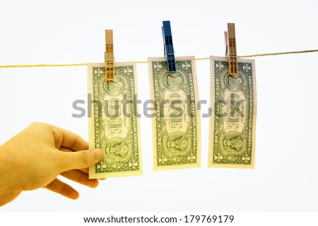Dollars on the wire isolated on white.