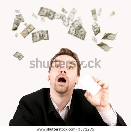 Dollars raining on a man with a blank card in his hand - stock photo