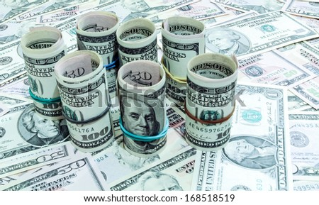 Dollars seamless background. High resolution wallpaper texture of rolled in a tube one hundred and flat fifty banknotes - stock photo