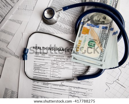 Dollars with stethoscope on them. Costs for the medical insurance.  - stock photo