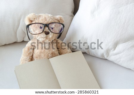 Dolly bears and   notebook on sofa in  living room - stock photo