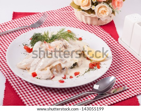 Dolly steak with seafood cream source - stock photo