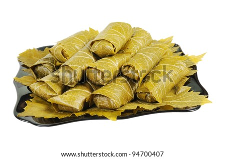 Dolma on a black plate. Isolated on white background. - stock photo