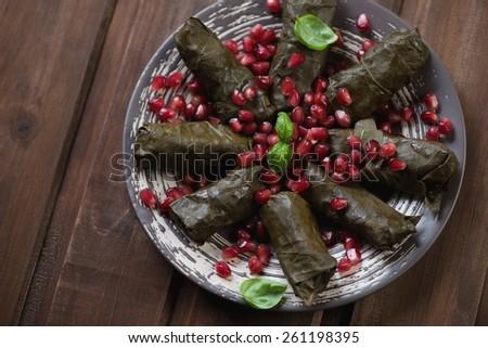 Dolma. Traditional eastern stuffed grape leaves. Studio shot - stock photo