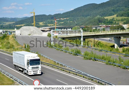 Dolny Hricov, Slovakia - June 29, 2016: White MAN truck drives on slovak D1 highway. In background is new part of this way under construction. - stock photo