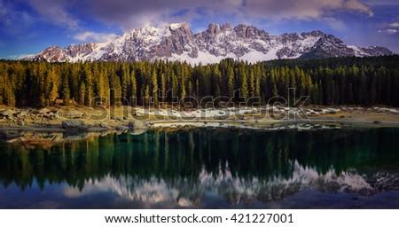 Dolomites Lake landscape with forrest mountain, Lago di Carezza, Italy - stock photo