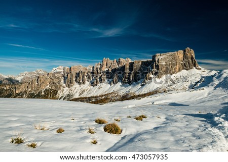 Dolomiti peaks and meadow with first autumn snow, italian beauty