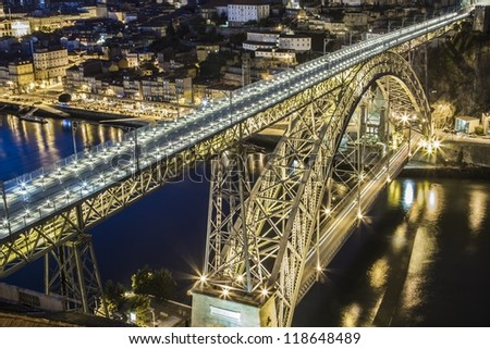 Dom Luis bridge over Douro river at night in Porto Portugal - stock photo