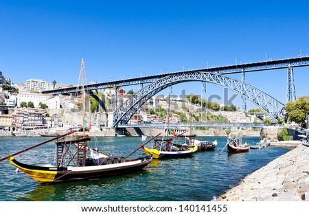 Dom Luis I Bridge and typical boats (rabelos), Porto, Portugal - stock photo