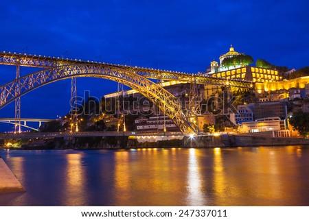 Dom Luis I bridge over Douro river and monastery of Serra do Pilar illuminated at night. Porto, Portugal  - stock photo