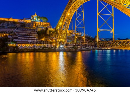 Dom Luis I metal arch bridge over Douro river, Oporto (Portugal) - stock photo