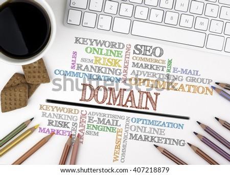 Domain word cloud, Business concept. White office desk - stock photo