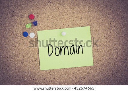 Domain written on sticky note pinned on pinboard - stock photo