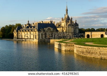 Domaine de Chantilly, a beautiful castle and chateau in Chantilly, France at the sunset. Popular tourist destination not far from Paris.