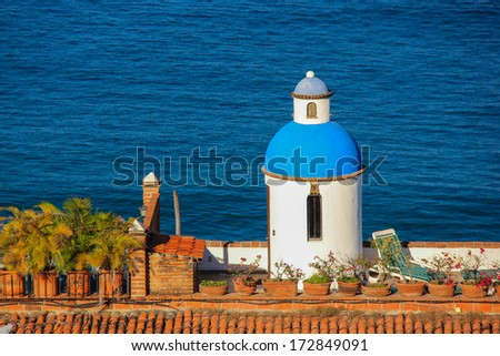 Dome and patio on a seaside building,  Puerto Vallarta, Mexico. with copy space - stock photo