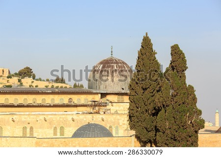Dome of mosque of Al-aqsa and cypresses in Jerusalem - stock photo