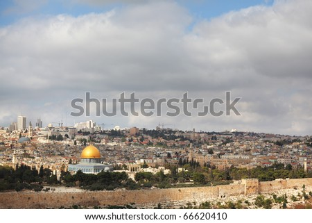 Dome of the Rock - a monument on the Temple Mount in Jerusalem. Gilded dome of the monument shining in the sun - stock photo