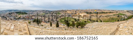 Dome of the Rock and Dome of the Holy Sepulcher in beautiful panorama of Jerusalem from Mount of Olives. - stock photo