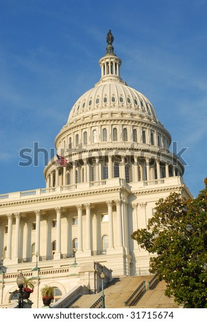 Dome of United States Capitol in Washington, DC.  International symbol of democracy, and one of the most monumental buildings in the world. - stock photo
