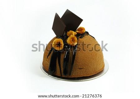 dome shaped chocolate mousse cake on isolated white background - stock photo