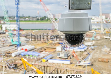 dome type outdoor cctv camera, secure construction site - stock photo