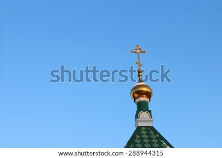Dome with cross on roof of Orthodox Church in winter sunny day - stock photo