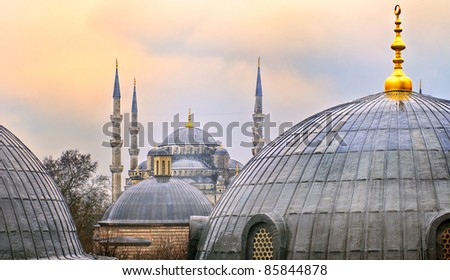 Domes of Blue Mosque in Istanbul on sunset - stock photo