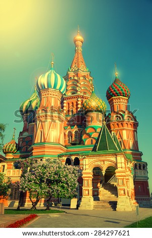 Domes of St. Basil's Cathedral in Moscow's Red Square in Russia in sunny summer weather. Vintage style - stock photo