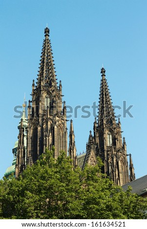 Domes of St.Vitus Cathedral over trees, Prague