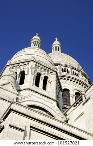 Domes of the Sacre Coeur Basilica in Montmartre, Paris over a deep blue sky