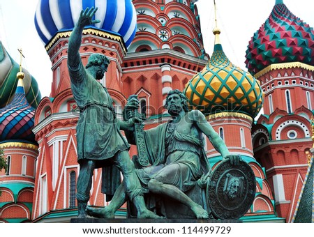 Domes on St. Basil's Cathedral with sculpture in foreground in Red Square, Moscow, Russia