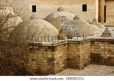 Domes over a traditional turkish bath in the Old City of Baku - stock photo