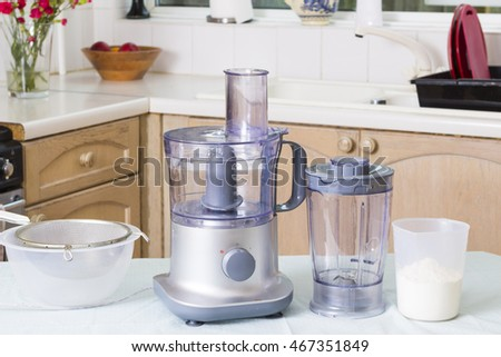 Domestic appliances (food processor) on kitchen table