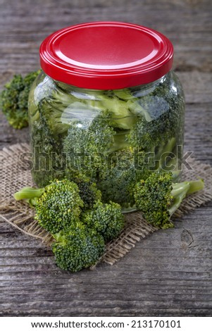 Domestic healthy canned broccoli on a wooden table