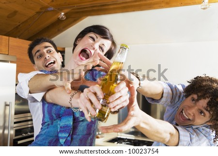 domestic life: friends competing for the last beer - stock photo