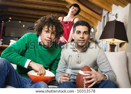 domestic life: group of friend watching a football match on tv - stock photo