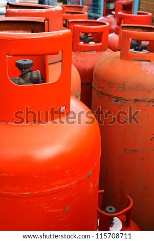 Domestic propane gas bottles ready to be refilled and recycled - stock photo