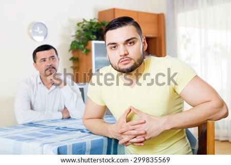 Domestic quarrel between senior father and  son  - stock photo