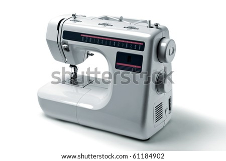 Domestic sewing machine on white background - stock photo