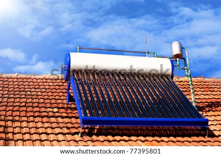 Domestic solar panel on a roof, with clear, cloudless sky - stock photo