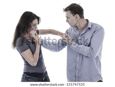 Domestic violence. Man beating woman - stock photo
