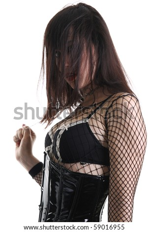 Dominant woman in sexy black stockings with belt. Domination concept. Studio shot. - stock photo