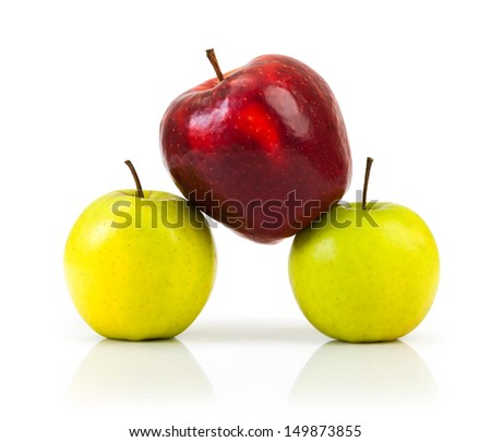 domination concepts - red apple between green apples  - stock photo