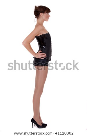 dominatrix woman in leather corsage and shorts