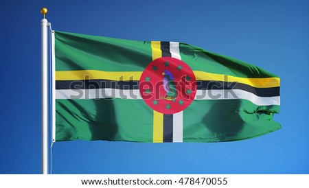 Dominica flag waving against clean blue sky, close up, isolated with clipping path mask alpha channel transparency