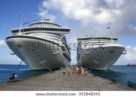 DOMINICA, LESSER ANTILLES - CIRCA 2008: Two cruise ships at dock - stock photo