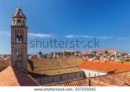 Dominican Monastery's bell tower and red roofs at the Old Town in Dubrovnik in Dubrovnik, Croatia. Copy space. - stock photo