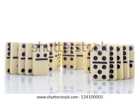 Domino effect - row of white dominoes isolated on white background